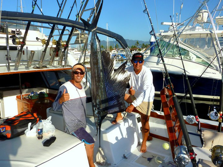 Sailfish at Cabo Corrientes. Pictured is First Mate Lobo and Capt. Cesar from Magnifico, one of the finest sportfishing boats in all of Puerto Vallarta!